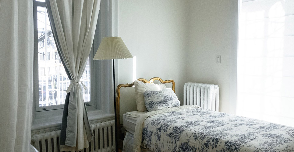 Picture of bed perfectly made in bedroom