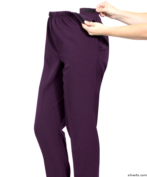 Women's purple adaptive open side pants demonstration of easy touch closures