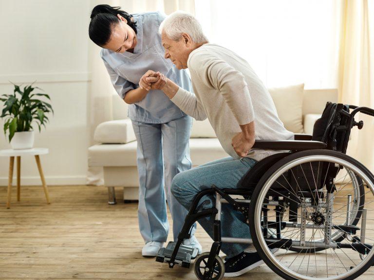 Caregiver Helping Patient