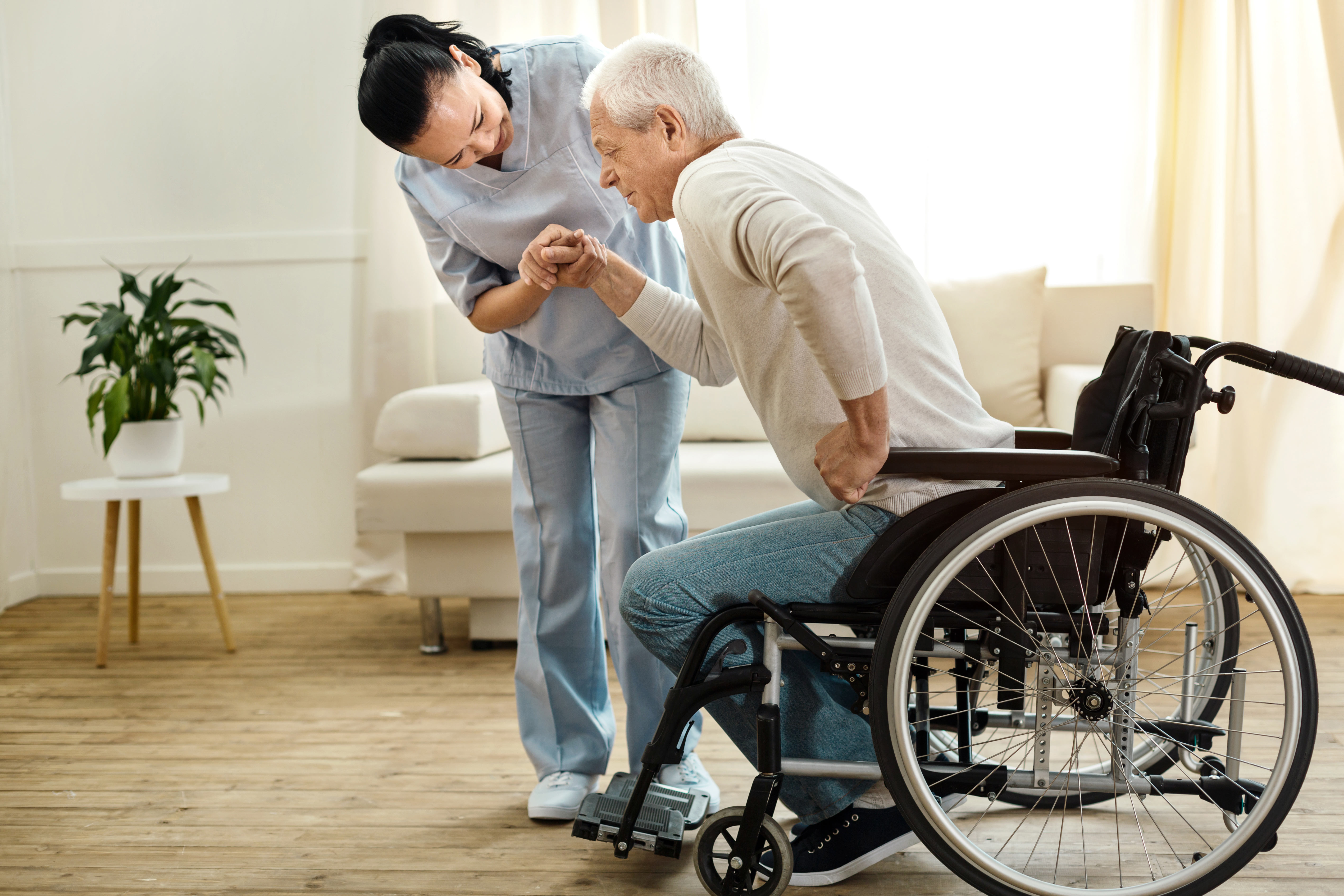 Caregiver Helping Patient