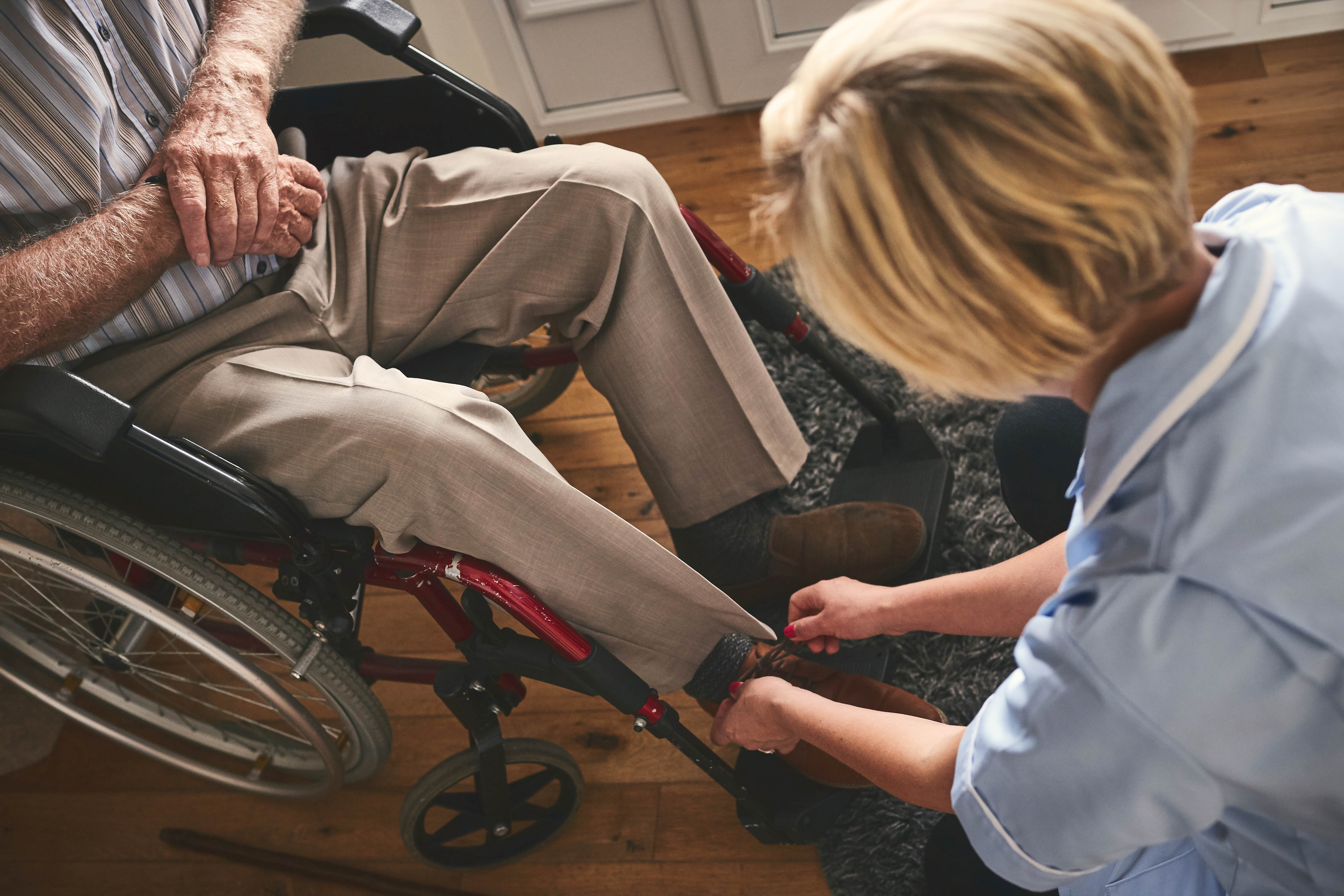 caregiver putting on adaptive footwear