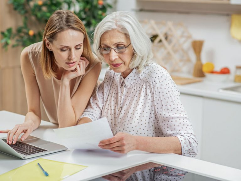 Mother and Daughter reviewing paperwork